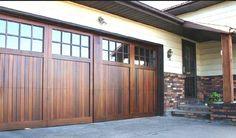 Brown wood look garage doors with glass window Wood Look Garage Doors Options and Benefits