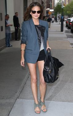 Chrissy Teigen rocks short-shorts and a blazer