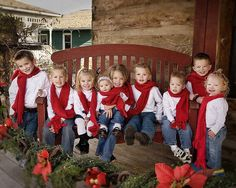 Christmas. Great idea for family photo…red scarves, white shirts, and blue jeans.