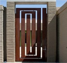 Selecting the apt front door can be more important than you think especially when contemplating about building your future home or even remodelling the existing one. Iron Main Gate Design, Gate Wall Design, House Main Gates Design, Steel Gate Design, Front Gate Design, Main Door Design, House Front Gate, Apartment Patio Gardens, Backyard Gates
