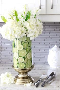 Add slices of lime to your vase for extra dimension. Get the tutorial at Summer Adams.
