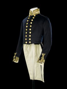 Royal Naval uniform: pattern 1843.  Double-breasted coat of blue wool facecloth worn by Admiral George Ourry Lempriere (1787-1864) while Rear-Admiral. The sleeves are gathered at the shoulders and on each shoulder of the bodice are four eyelets for securing epaulettes. The sleeves terminate in a mariner's cuff. The slash is of blue wool edged with gold lace and has three small gilt brass buttons. The cuff is of white twill wool with a wide border of gold lace.