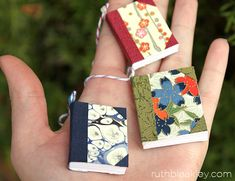 Tiny books to use to make napkin rings or what? Handful of handmade book Christmas tree ornaments by Ruth Bleakley