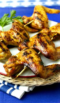 Barbecued Chicken Wings - Who doesn't love barbecued chicken wings? As a fun finger food, they are perfect for outdoor dining! Barbecuing brings out the flavor of wings, as does this special sauce created by Chef James Brockman.