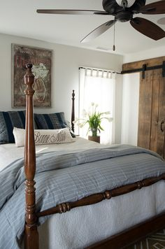 Prefabricated Beach House with Small Coastal Interiors -  Space is at a premium in the master bedroom, but style has made its way to this room as well! Barn doors made from reclaimed wood conceal the closet and add a rustic touch. They have a special meaning to the homeowner; the wood was reclaimed from a building on her family's farm in Vermont. - image 12 of 15.◆