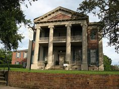 Magnolia Hall of Natchez, Mississippi, is also known as the Henderson-Britton House and was built in 1858. As a Greek Revival mansion it is a contributing property to the Natchez On Top of the Hill Historic District, listed on the National Register of Historic Places.