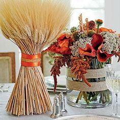 Give a nod to the harvest by pairing autumnal floral arrangements with bundles of wheat sheaves; wrap them in burlap and satin ribbons.
