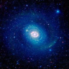 A striking image of galaxy Messier 94, captured in 2004 by the Spitzer Space Telescope.