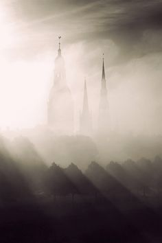 Towers of Riga, Latvia surrounded by fog by Mariss Balodis, via Flickr