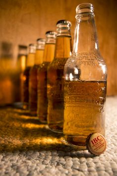 This is one of my favorite photos I've taken because of the repetition, lighting, and isolation. The light shining through the bottles creating an amber shadow is awesome.