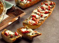 French bread layered with pesto, tomatoes and cheese - broiled into a delicious appetizer that serves a bunch. Ready in just 15 minutes!