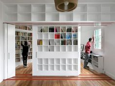 Sliding Library Instantly Creates Extra Studio at Hip Buenos Aires Apartment