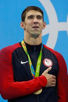 Gold medalist Michael Phelps of the United States poses on the podium during the…