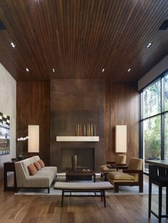 wood paneling, high ceilings, vertical lines, neutral color scheme, warm tones
