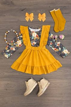 Your girl will fall in love with the simple and sleek style of this suede suspender skirt set. A long sleeve floral print top paired with a mustard suede suspender skirt with ruffle suspenders to complete the look. Baby Outfits, Little Girl Outfits, Kids Outfits Girls, Cute Outfits For Kids, Toddler Girl Outfits, Baby Girl Dresses, Baby Dress, Little Girl Skirts, Baby Girl Fashion