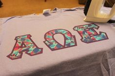 As I mentioned, I've been on the production line of many (and might I add, adorable) t-shirts sporting a set of Greek letters. Most of them have been for my own sorority, Alpha Omega Epsilon, but. Sorority Letters, Diy Letters, Sorority Crafts, Sorority Shirts, Letter Crafts, Alpha Phi Omega, Alpha Sigma Alpha, Sigma Kappa, Chi Omega