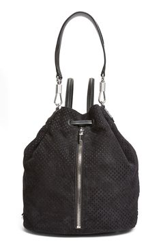 Upping the street-style game with this edgy Elizabeth & James perforated sling backpack that exemplifies chic versatility.