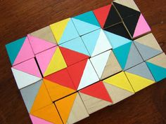 hand painted wood cubes or tiles in bright colors with geometric shapes