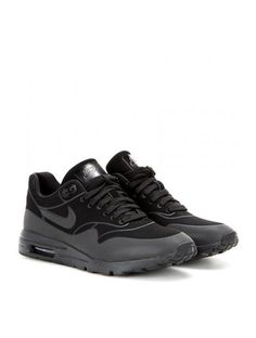 3b1144bd4e6 Nike s  Air Max 1 Ultra  sneakers are the perfect way to bring an urban  twist into your wardrobe. Wear these all-black sneakers with workout gear  and floaty ...