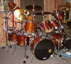 """06.17.13: Roger Cunningham's 1982 #Tama Superstar in Super Mahogany finish is our #Drum Kit of the Week! The photo was taken right after he rebuilt it and added the drum rack and Speed Cobra pedals.Roger says, """"It's comprised of 2-24""""x14"""" bass drums, a 6""""(not shown) 8"""", 10"""" and 12"""" concert toms, 13""""x9"""", 14""""x10"""", 15""""x11"""" toms and 16""""x16"""" and 18""""x16"""" floor toms."""" Thanks for being a part of the Tama family!"""