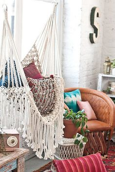 Decorate with macrame wall hangings and hammocks. | 17 Ways To Transform Your Home Into A Hippie Heaven