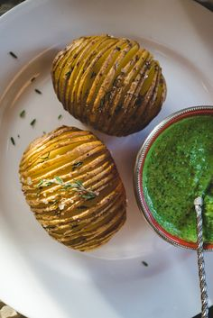 Rosemary Hasselback potatoes with parsley & pumpkin seed pesto. Real vegan comfort food!