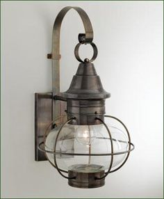 "Vidalia Onion Side Mount - A New England favorite onion lantern with clear glass. Four color choices - three brass finishes  and a natural copper. Small Side Mount 8 3/4"" W. 17 5/8"" H. Medium 11 3/8"" W. 20 7/8"" H."