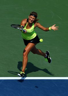 Victoria Azarenka of Belarus returns a shot during her women's singles semifinal match against Maria Sharapova of Russia on Day Twelve of the 2012 US Open