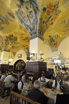 """Hofbrauhaus, Munich Germany The loud ambience, the beautiful (and strong) waitresses, the painted ceiling and German Oompah music…. It must be time for Beer and Pretzels. """"Eins, Zwei, Drei g'suffa"""" (1,2,3 Chug)"""