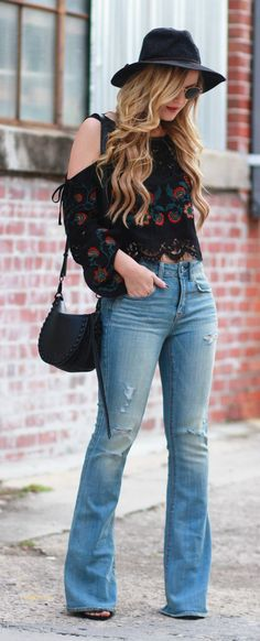 Boho casual fall outfit styled with embroidered bell sleeve top, flared jeans, and round Ray Ban sunglasses