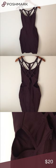 Strappy Bodycon Dress with Cutouts Super sexy bodycon dress with cutouts at the waist. Stretchy fabric. M but could fit like a Small. Wine/plum color. Great for any season! Dresses
