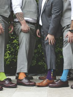 Each groomsman wearing a different pair of bright colored socks // Finding Light Photography