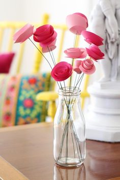"Paper flowers are a creative and economic way to add color and cheer to your space. These particular flowers are a favorite because they don't come across as overly ""crafty"" and you can make large quantities in hardly any time at all. As an added bonus, construction is simple and requires nothing more than scissors and quick-drying glue."