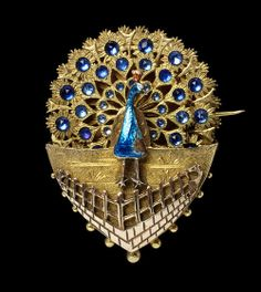Victorian Era Fan Guide | A brooch from the 1880s with a clockwork ...