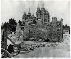 A portion of a stone wall is seen as it is torn down in the 1870s to make way for other buildings at Temple Square in Salt Lake City.