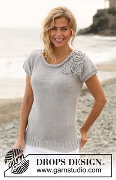 """Knitted DROPS roll neck sweater with crochet flowers in """"Paris"""". Size: S - XXXL. ~ DROPS Design"""