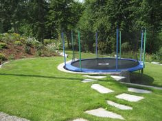 Could do something similar along the side yard where w… Clever landscaping idea. Could do something similar along the side yard where we'd like to reshape our slope and put a terraced garden and hot tub in. Backyard Trampoline, Backyard Play, Backyard Fences, Backyard For Kids, Backyard Ideas, Ground Trampoline, Garden Stairs, Garden Kids, Terraced Backyard