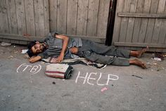 Steve McCurry, INDIA. Bombay. 1993. A man lays on the ground.                                                                                                                                                                                 More