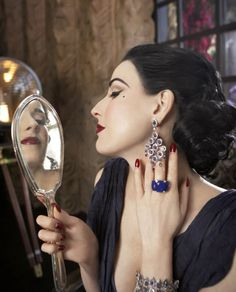 Dita Von Teese. Makeup: Gregory Arlt. Hair: Danilo. Stylist: Trish Summerville. Photo: Steve Erle.