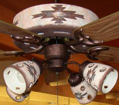 Southwestern Ceiling fan! Gonna change them all out to this style but various colors