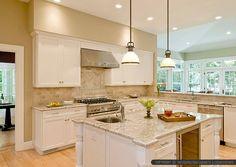Bianco romano granite countertop beige kitchen cabinets with subway travertine backsplash tile. Travertine backsplash tile design ideas.
