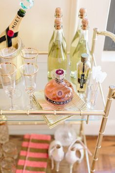 More mixers: http://www.stylemepretty.com/living/2014/02/18/how-to-stock-a-bar-cart/