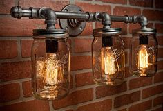 Mason Jar Light Fixture - Industrial Light - Light - Rustic Light - Vanity Light - Wall Light - Wall Sconce - Steampunk Light - A handmade industrial chic three light is that add a truly charming accent to any home. Farmhouse Lighting, Rustic Lighting, Unique Lighting, Industrial Lighting, Lighting Design, Industrial Chic, Industrial Chandelier, Lighting Ideas, Industrial Furniture