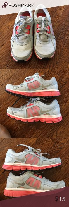 Nike Dual fusion ST2 running shoe. Used. Size 6.5 Nike Dual fusion ST2 running shoe. Size 6.5. Used condition but still have a good amount of life in them (see picture). Will clean up nicely i think. Grey and neon pink. Willing to take offers. Nike Shoes Sneakers