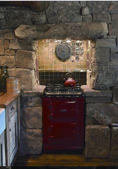 Cabin kitchen. Too small, but I like hearth idea around the stove