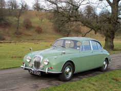 Daimler V8-250 (1968). Bought it to replace stolen Rover. Beautiful car and the V8 sounds great.
