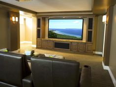 The family theater room is complete with surround sound, accent lighting and high-definition projector screen