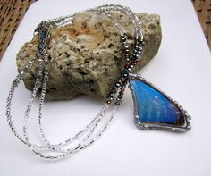 Real Butterfly Necklace, Morpho Zephyritis, Blue Morpho. $62.00, via Etsy.