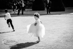 Cute flowergirl running at the Conservatory at Syon Park