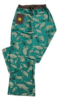 Super cute and light material that you can wear year round, even here in Florida! Covered in manatees from top to bottom, with a drawstring closure. They are 100% cotton and come in four junior women sizes: S(3-5), M(7-9), L(11-13), XL(15-17). You can match them with our NO WAKE ZONE charcoal gray Pj T-Shirt or the ribbed charcoal gray Pj fitted Tank.  These sharp looking pants look good with everything.